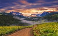 Amazing purple sunset above the foggy valley wallpaper 2560x1600 jpg