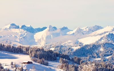 Amazing sunny day over the snowy mountains Wallpaper