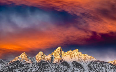 Amazing sunset sky above the snowy mountains wallpaper