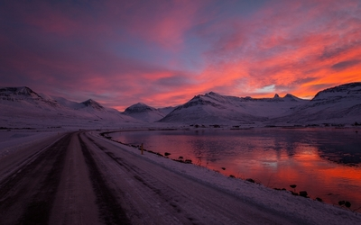 Amazing sunset sky behind the snowy hills wallpaper
