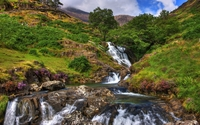 Amazing waterfall pouring from the green hill wallpaper 2560x1600 jpg