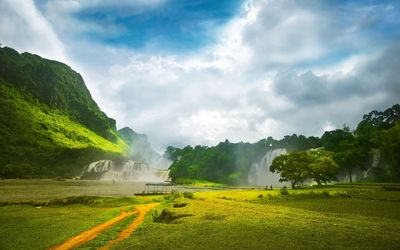 Amazing waterfalls between green hills wallpaper