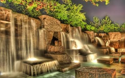 Artificial waterfall in a garden wallpaper