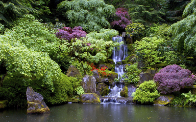 Artificial waterfall in the beautiful garden wallpaper