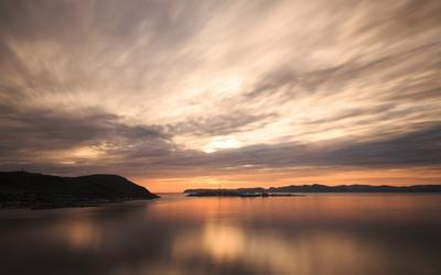 Beautiful sunset sky above the small island wallpaper