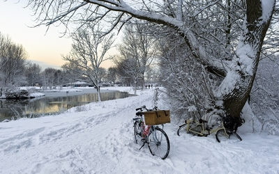 Bikes in the snow by the river wallpaper