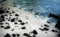 Black rocks on a sandy beach wallpaper 1920x1200 jpg