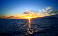 Blue ocean water reflecting the gilded sunset wallpaper 1920x1200 jpg