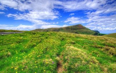 Blue sky over the green hills Wallpaper