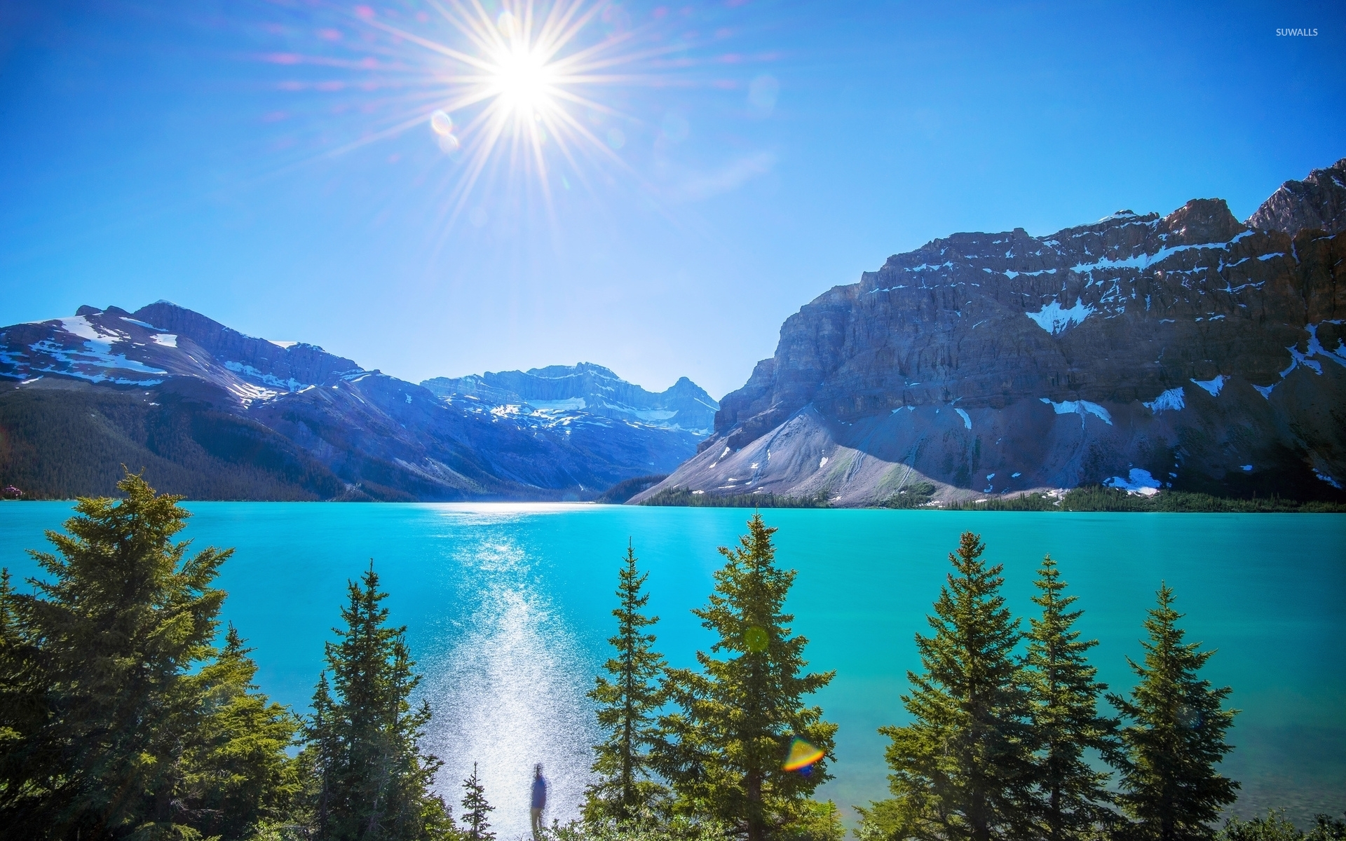 Bright sun in the clear sky above the mountain lake wallpaper