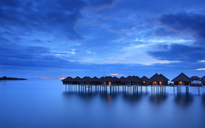 Bungalows in the blue sunset Wallpaper