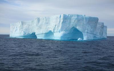 Caves in an iceberg wallpaper