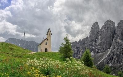 Church aside the rocky peaks Wallpaper
