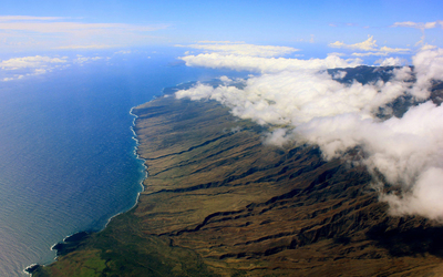 Cloud blanket over Maui wallpaper