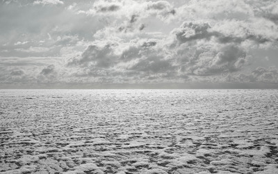 Clouds over the frozen tundra wallpaper