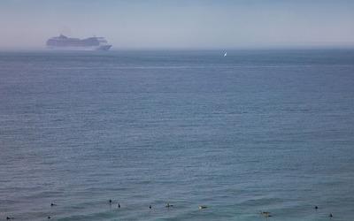 Cruise ship close to the beach wallpaper