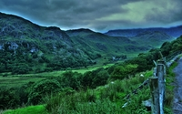 Dark clouds above the green hills wallpaper 2560x1600 jpg