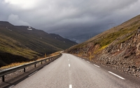 Dark clouds above the mountain road wallpaper 1920x1200 jpg
