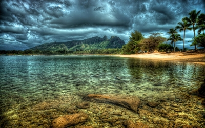 Dark clouds over the rocky lake wallpaper