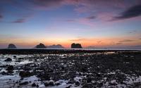 Dark rocks bathing in the warm sunset light wallpaper 2560x1600 jpg