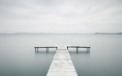 Dock on a misty lake wallpaper