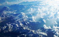 Fluffy clouds above the snowy mountains wallpaper 1920x1200 jpg