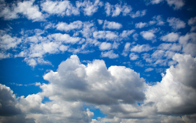 Fluffy clouds on the deep blue sky wallpaper