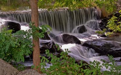 Foamy waterfall in the forest wallpaper