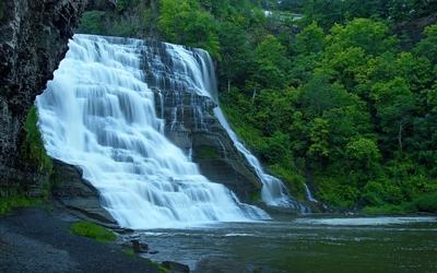 Foamy waterfall on rocky river wallpaper