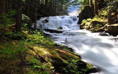 Foamy waterfall on the mountain river wallpaper