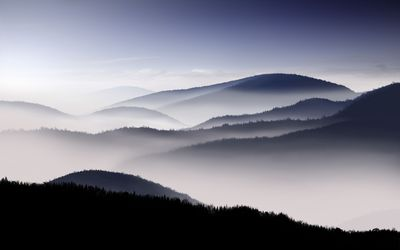 Fog covered mountain range wallpaper