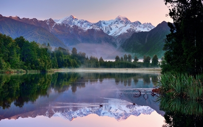 Fog rising from the mountain lake on a beautiful autumn day wallpaper