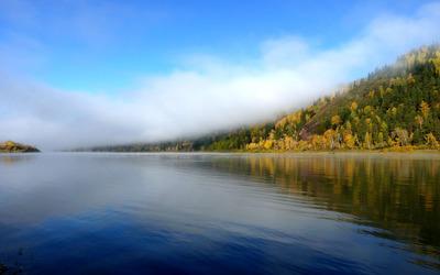 Foggy mountain by the lake wallpaper