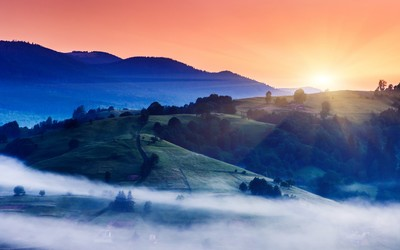 Foggy trails in the valley at sunset wallpaper