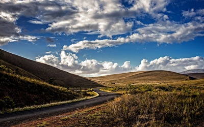Fuzzy clouds above the road wallpaper