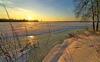 Golden sunset above frozen water wallpaper 1920x1200 jpg