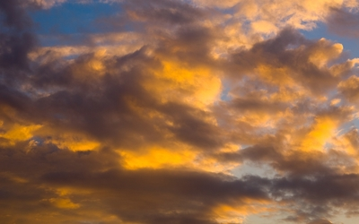 Gray and yellow fuzzy clouds Wallpaper