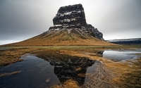 High rocky hill reflected in the small lake wallpaper 2560x1600 jpg
