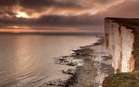 High rocky ocean shore at sunset wallpaper 1920x1200 jpg