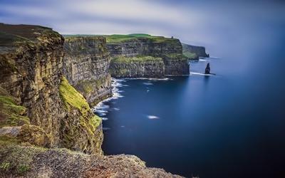 High rocky shore to the ocean wallpaper
