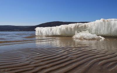 Ice on the sandy beach wallpaper