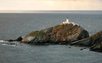 Lighthouse on a rocky cliff wallpaper 1920x1200 jpg