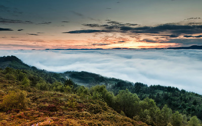 Low clouds over mountains wallpaper