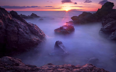 Misty purple water at sunset wallpaper