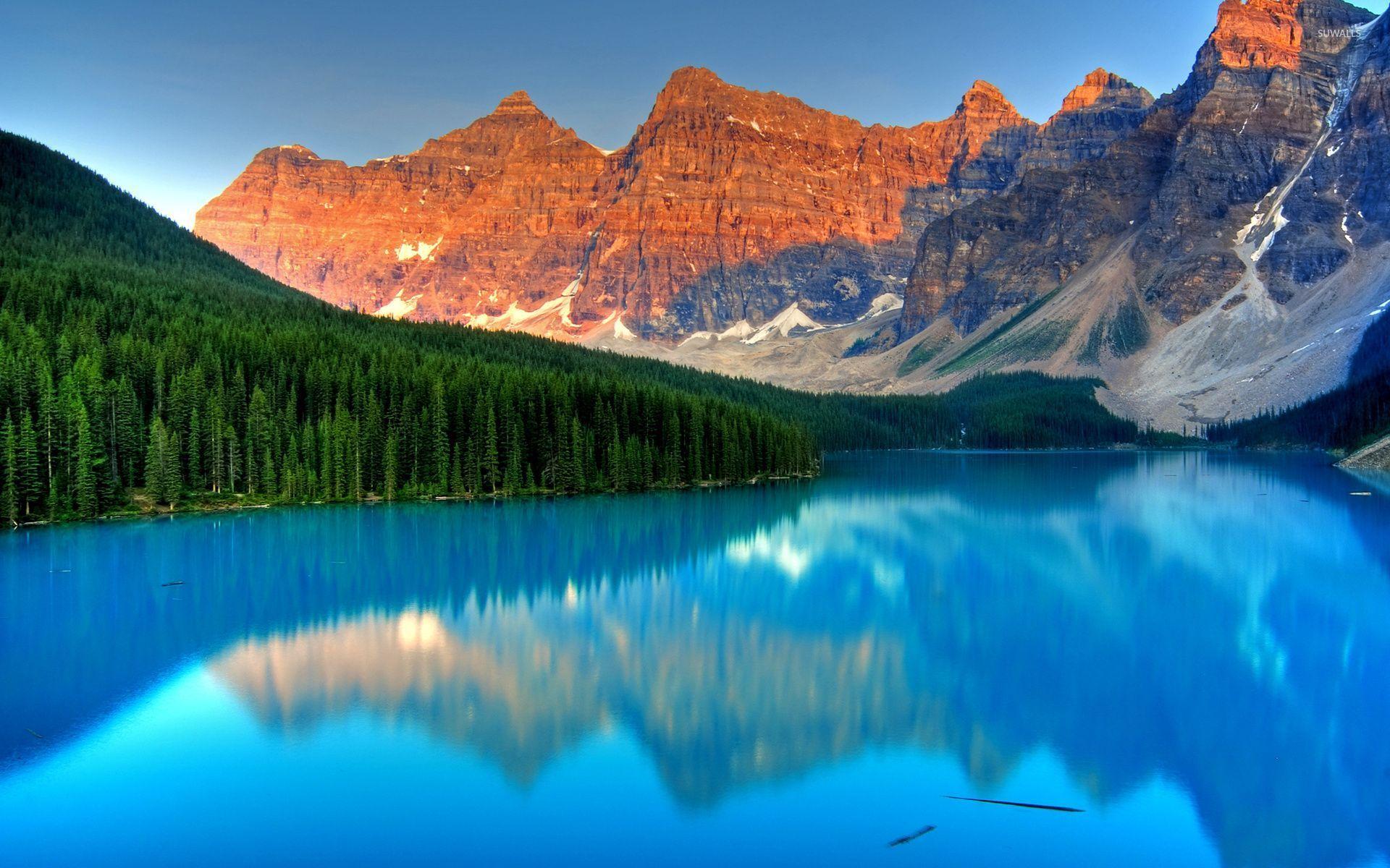 Beautiful Blue Clear Water In Moraine Lake Wallpaper