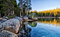 Mossy rocks pilling on the lake shore in Yosemite National Park wallpaper 1920x1200 jpg