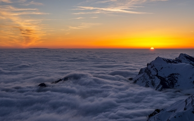 Mountain peaks over the clouds wallpaper