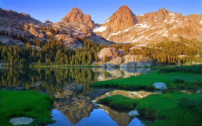 Mountain peaks reflecting in the mirror of the lake Wallpaper