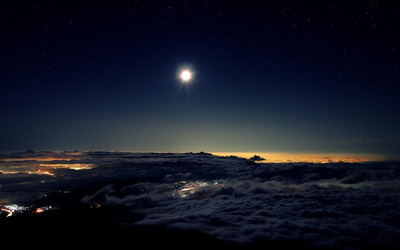 Night sky above the clouds wallpaper