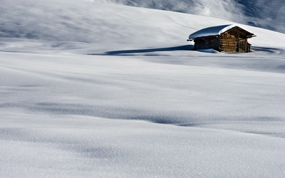Old hut surrounded by snow wallpaper